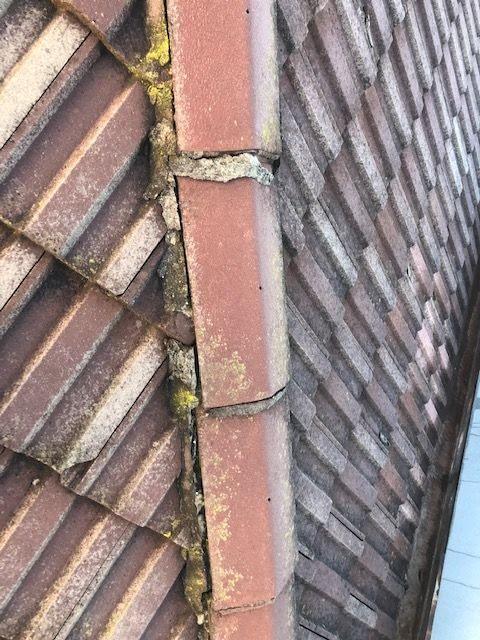 Damaged ridge cap tile roof