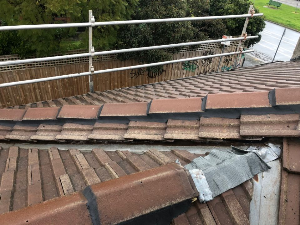 damaged ridge capping on a tile roof causing chimney roof leaks